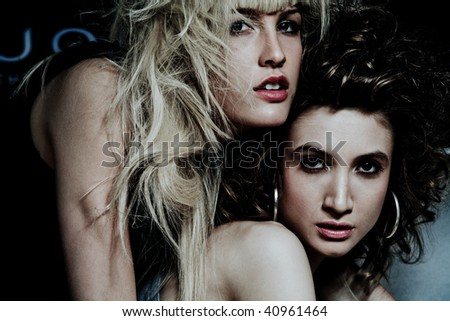 couple of beautiful girls, indoor shot - stock photo