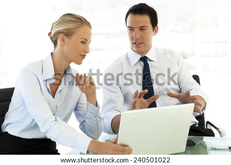 Couple of Business partners working together on laptop