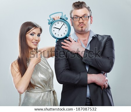 Couple of business people, time concept in business.