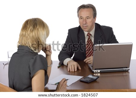 couple of businesspeople at the table with laptop