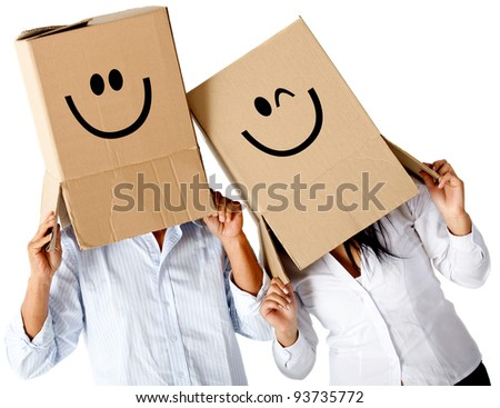 Couple of cardbord characters with smiley faces - isolated over a white background - stock photo