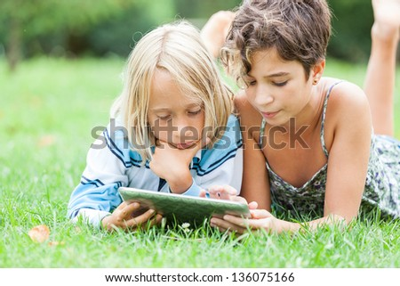 Couple of Children with Tablet PC