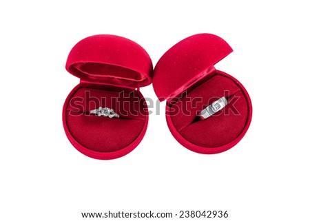 Couple of diamond rings on isolated white background - stock photo