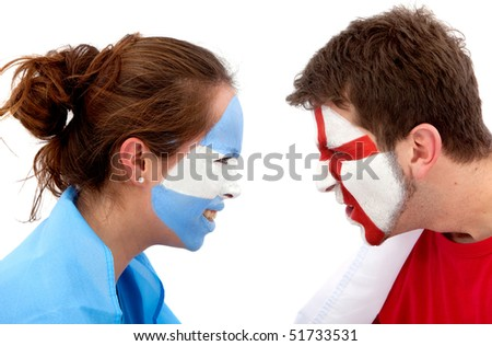 Couple of football fans with their faces painted isolated over white - Argentina versus England - stock photo