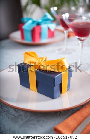 couple of gift boxes on white plates at restaurant