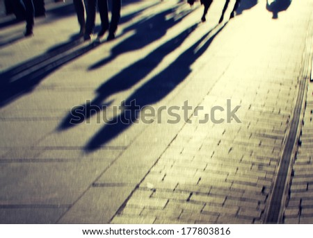 couple of lovers on the cobblestone pavement at sunset - stock photo