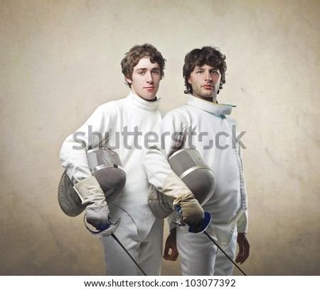 Couple of male fencers - stock photo