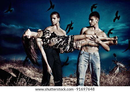 couple of men hold  young woman , night scene, birds fly over  night sky, small  amount  of grain added - stock photo