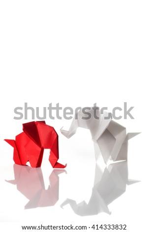Couple of origami elephants isolated on white background - stock photo