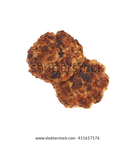 Couple of prepared small hand made cutlets isolated over white background - stock photo