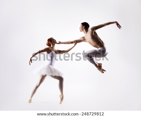 Couple of sporty ballet dancers in a classic performance - stock photo