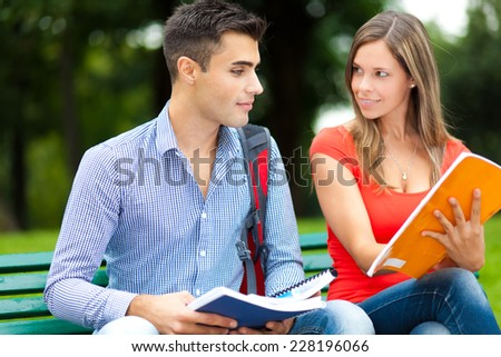 Couple of students studying together - stock photo