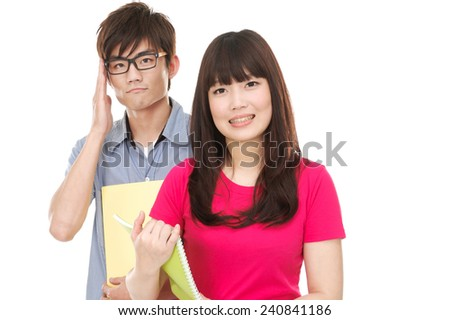 Couple of students with notebooks - stock photo