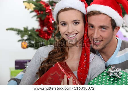 Couple of teenagers at Christmas. - stock photo