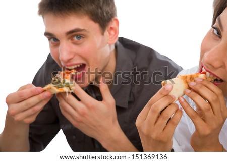 couple of teenagers eating pizza - stock photo