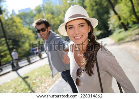 Couple of tourists having fun walking in Central Park - stock photo
