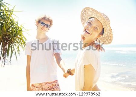 Couple of tourists on beach - stock photo
