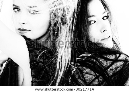 couple of women portrait in black and white - stock photo