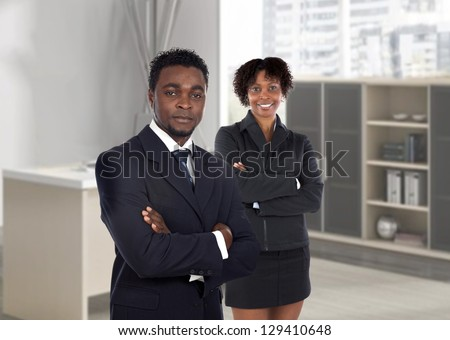 Couple of young african executives in the office