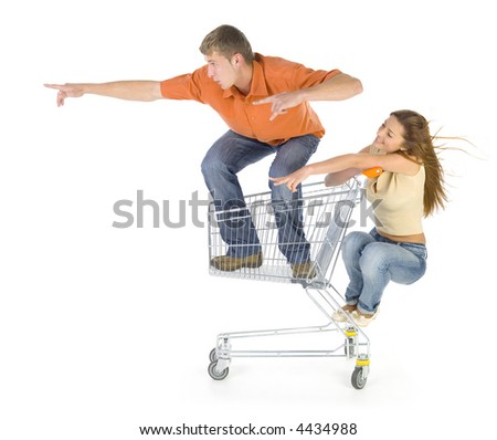 Couple of young people riding by trolley. Having fun. Isolated on white in studio. Showing something. Side view - stock photo