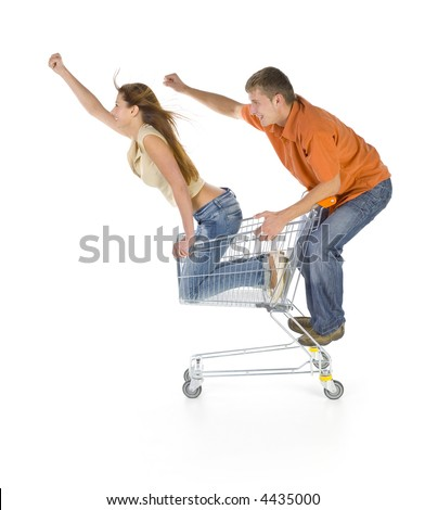Couple of young people riding by trolley. Having fun. Isolated on white in studio. Side view - stock photo