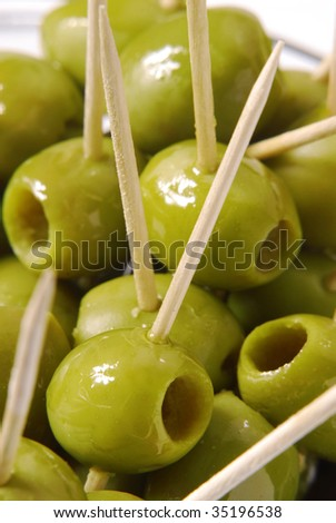 Couple olives in a plate.Punctured olives. - stock photo