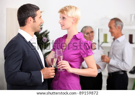 couple on a family dinner drinking champagne - stock photo