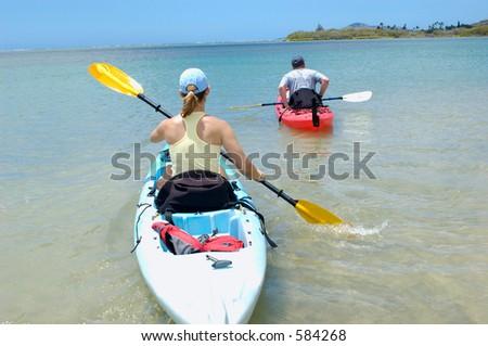 couple on a kayak - stock photo