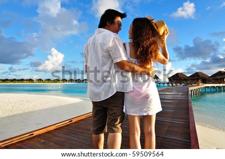 Couple on a pathway of luxury resort, Maldives - stock photo