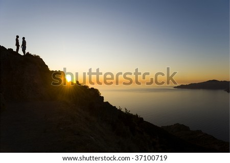 couple on a rock - stock photo