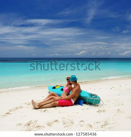 Couple on a tropical beach - stock photo