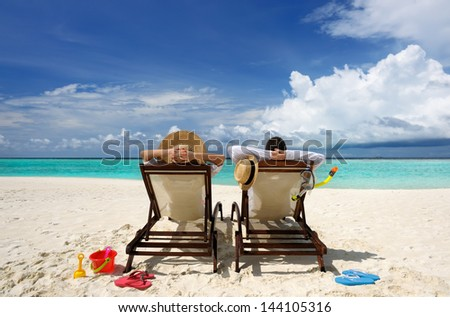 Couple on a tropical beach at Maldives - stock photo