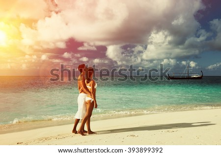 Couple on a tropical beach at Maldives