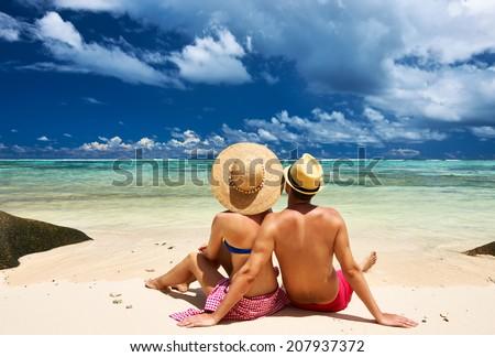 Couple on a tropical beach at Seychelles - stock photo