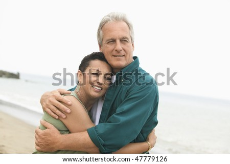 Couple on Beach - stock photo