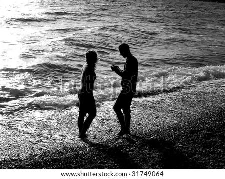 Couple on beach. Image for romantic scene. - stock photo