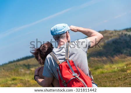 Couple on hike looking at the mountain landscape