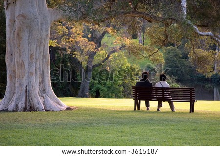 Couple On Park Bench
