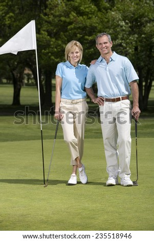 Couple on Putting Green - stock photo