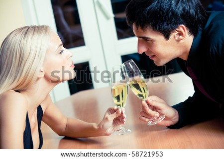 Couple on romantic date or celebrating together at restaurant - stock photo