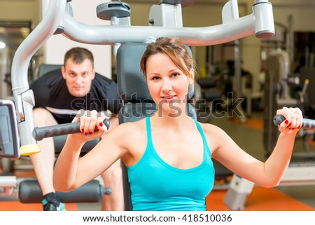 couple on simulators in the gym spends leisure - stock photo
