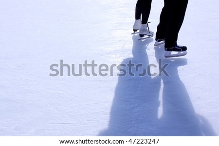 couple on skating rink - stock photo