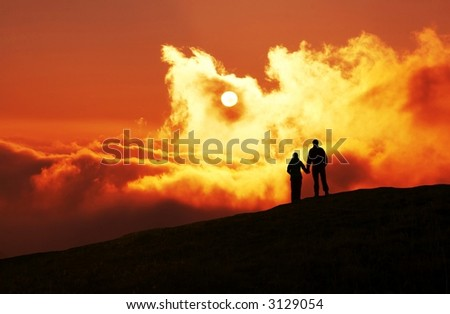 Couple on sunset background - stock photo