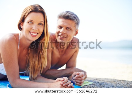 Couple on the beach - stock photo