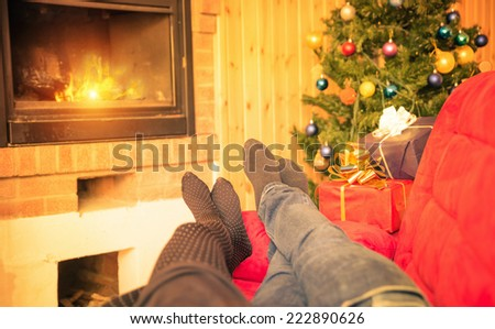 couple on the couch enjoying christmas time. concept about christmas atmosphere - stock photo