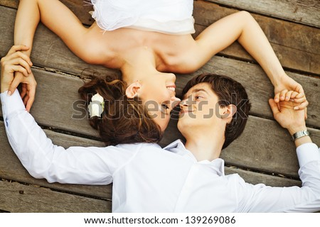 couple on the floor (soft focus on the eyes of bride) - stock photo