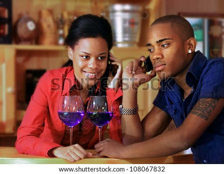 Couple on the phone - stock photo