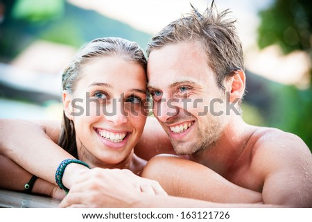 couple on the swimming pool have fun - Stock Image