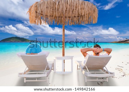 Couple on tropical holidays at the sea - stock photo