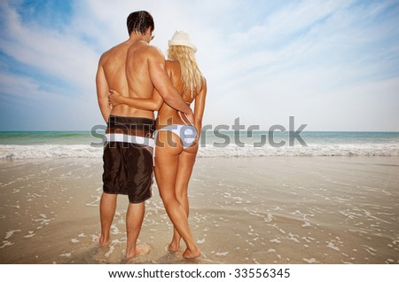 Couple on vacation standing at the beach.